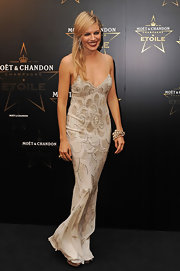 Sienna Miller attended the Moet & Chandon Award ceremony in this gorgeous full-length embellished gown by Christian Dior.