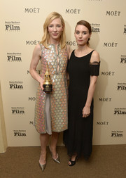Rooney Mara complemented her frock with black platform sandals by Jimmy Choo.