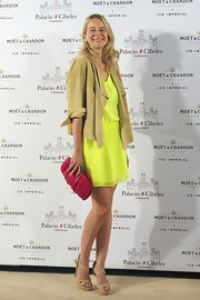 Maria Leon's bright pink clutch popped against her neon yellow dress at a Moet & Chandon party in Madrid.