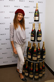 Maggie Q accentuated her super-slim legs with a pair of white skinny jeans at the US Open Moet & Chandon suite.