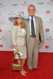 Chris Riley attended the Kentucky Derby Moet & Chandon toast carrying a chic quilted gold leather bag.