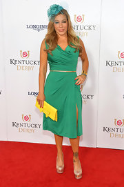 Taylor Dayne looked very feminine in a green cowl-neck dress with a thigh-high slit at the Kentucky Derby Moet & Chandon toast.