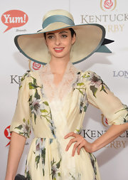 Krysten Ritter accessorized with an elegant wide-brimmed straw hat at the Kentucky Derby Moet & Chandon toast.