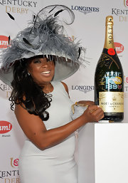 Star Jones wore a very dramatic gray hat with towering feathers at the Kentucky Derby Moet & Chandon toast.