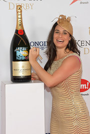 Jen Fruzzetti complemented her glittery dress with a gold fascinator when she attended the Kentucky Derby Moet & Chandon toast.