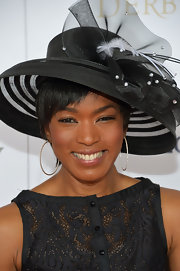 Angela Bassett was all dolled up in diamond hoops and a fancy hat at the Kentucky Derby Moet & Chandon toast.