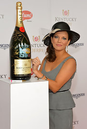 Martina Mcbride topped off her ensemble with a feathered black hat at the Kentucky Derby Moet & Chandon toast.