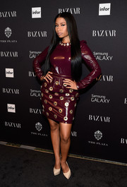 Nicki Minaj attended the Harper's Bazaar Icons event looking sleek in an embellished maroon dress by Marc Jacobs.