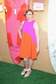 Lena Dunham couldn't be missed in her magenta and orange Lisa Perry dress at the Paddle for Pink event.