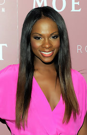 Tika Sumpter kept it simple yet elegant with this glossy straight 'do at the launch of Kelly Rowland's album.