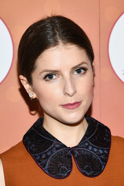 Anna Kendrick opted for a simple center-parted updo when she attended Mohegan Sun's 20th anniversary party.