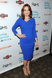 Tina Fey showed off her curves in a blue figure-flattering cocktail dress.