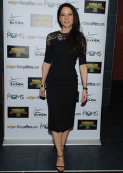 Lucy Liu was demure and classic in a little black dress with a lacy yoke at the Moms Mamarazzi 'Kung Fu Panda' 3 screening.