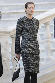 Charlotte Casiraghi paired her suit with a black suede shoulder bag.