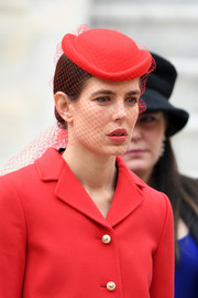 Charlotte Casiraghi looked fancy wearing this veiled red hat at the 2016 Monaco National Day celebration.