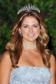 Princess Madeleine accentuated her swan-like neck with a thick collar necklace at the Monaco Royal Wedding.