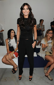 The stunning Elisabetta Gregoraci opted for an eternally stylish black-on-black T-shirt and slacks ensemble at the Moncler Gamme Bleu runway during Fashion Week.
