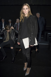 Olivia Palermo was tough-chic in her all-black suede jacket, top, and leather skinnies combo at the Moncler Gamme Rouge fashion show.