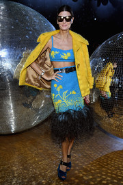 Giovanna Battaglia rounded out her all-Prada look with a pair of blue and black cross-strap platforms.
