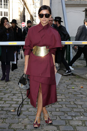 Miroslava Duma looked oh-so-cool in an ultra-modern burgundy coat by A.W.A.K.E. during the Moncler Gamme Rouge fashion show.