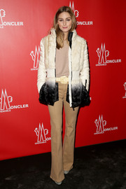 Olivia Palermo attended the Moncler show in one of their own white jackets that faded to  black.