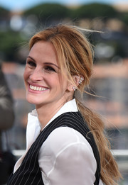 Julia Roberts swept her locks back into a loose ponytail for the Cannes photocall for 'Money Monster.'