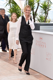 Julia Roberts worked an adrogynous vibe in a Givenchy by Riccardo Tisci pinstripe jumpsuit layered over a white button-down at the Cannes photocall for 'Money Monster.'