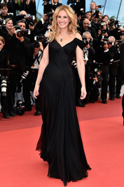 Julia Roberts kept it timeless in a drapey black off-the-shoulder gown by Armani Prive at the Cannes premiere of 'Money Monster.'