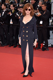 Susan Sarandon showcased both cleavage and legs in a low-cut, high-slit tuxedo gown by Jean-Paul Gaultier at the Cannes premiere of 'Money Monster.'