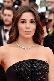 Eva Longoria wore her hair loose with a center part and gentle waves at the Cannes premiere of 'Money Monster.'