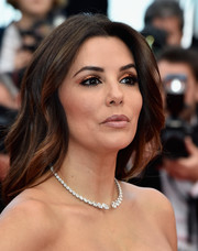 Eva Longoria polished off her look with a Messika diamond necklace.