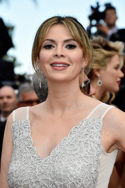 Carly Steel styled her hair into a loose center-parted updo for the Cannes premiere of 'Money Monster.'