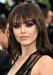 Kristina Bazan attended the Cannes premiere of 'Money Monster' wearing a long wavy 'do with wispy bangs.