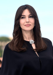 Monica Bellucci opted for a classic feathered flip when she attended the Cannes Film Fest Mistress of Ceremonies photocall.
