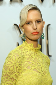 Karolina Kurkova's orange lipstick contrasted beautifully with her yellow frock.