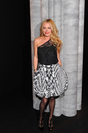 Cat Deeley kept it classic up top in a black lace one-shoulder blouse by Monique Lhuillier during the label's fashion show.