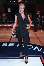 Paris Hilton was modern and stylish in a black Monse tuxedo vest with an asymmetrical hem during the brand's fashion show.