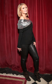 Paris Hilton teamed a sequin-embellished off-the-shoulder sweater with black leather leggings for the Monse launch party.