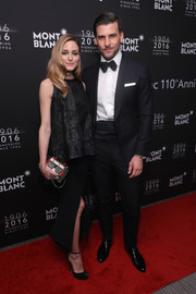 Olivia Palermo complemented her blouse with a black high-slit skirt, also by Toni Maticevski.
