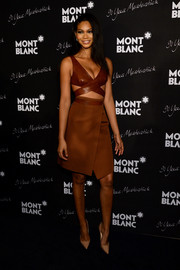 Chanel Iman looked va-va-voom in a brown dress with a crisscross cutout bodice during the Montblanc Meisterstuck 90th anniversary celebration.