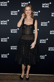 Eva Herzigova wore a sheer black corset dress with a full skirt for the Princess Grace dinner in Switzerland.
