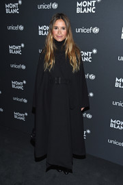 Miroslava Duma bundled up in a voluminous black wool coat for the Montblanc & UNICEF Gala.
