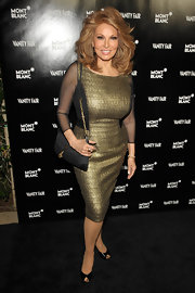 Raquel Welch kept her party style sophisticated with a black evening purse with a gold chain strap.