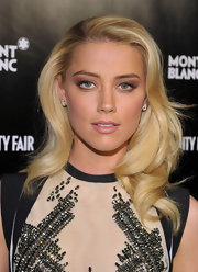 Amber Heard attended the Montblanc 'Vanity Fair' Party in LA wearing her hair in smooth waves.