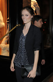 Coco Rocha accented her casual party style with a black patent and leather envelope clutch.