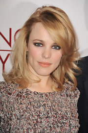 Rachel McAdams toned down their look with a swipe of nude gloss.