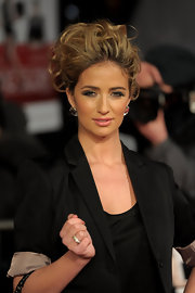 Chantelle wears her hair in a messy updo for this voluminous style.