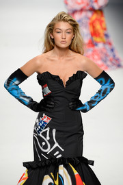 Gigi Hadid wore graffiti-print gloves to match her mermaid gown at the Moschino Fall 2015 show.