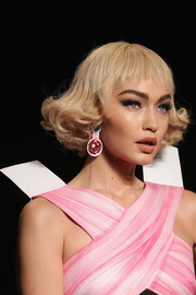 Gigi Hadid rocked short curls with wispy bangs at the Moschino fashion show.