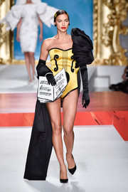 Irina Shayk channeled her inner showgirl in a music-motif bodysuit at the Moschino Spring 2020 show.